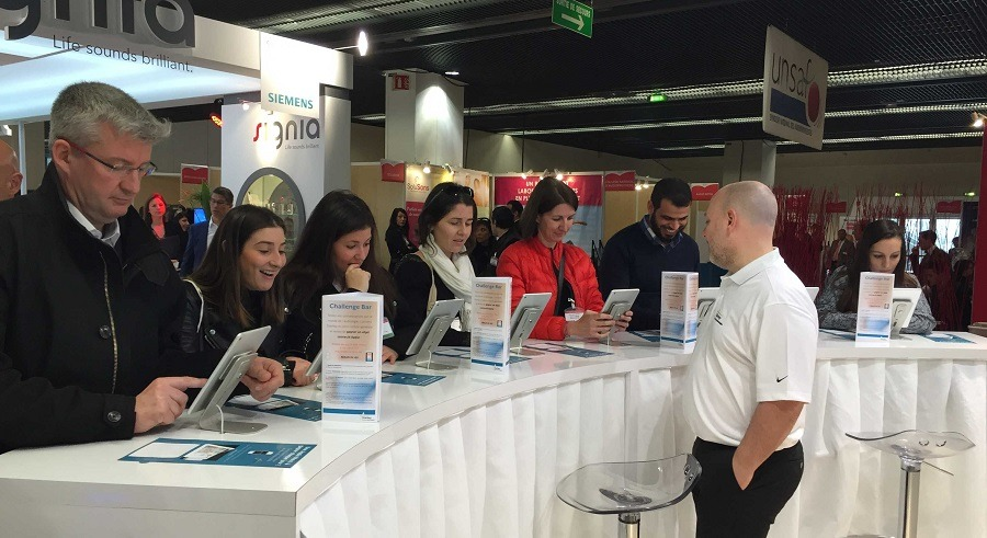 crowd gathers to play trade show trivia game