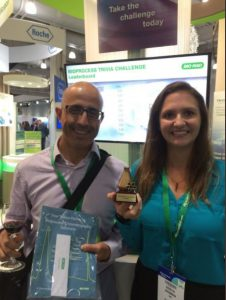 trade show trivia game winner with prize and trophy